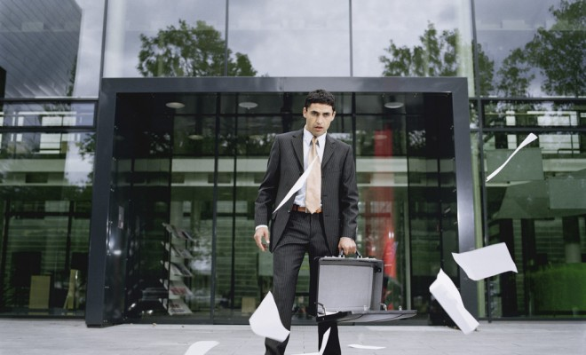 Wind Blowing Papers from Businessman's Briefcase